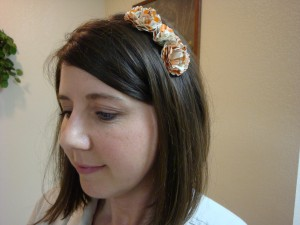 Even small book flowers hotglued to a plastic headband make an eye-catching accessory.